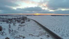 Aerial view of cars moving on winter road. stock video