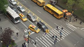 Aerial view of cars and pedestrians at an intersection. A view of a typical New York City intersection stock footage