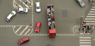 Aerial view of cars and people, busy traffic in big intersection Royalty Free Stock Image