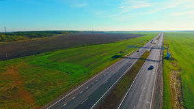 Aerial view of cars ride on highway road. Cars driving on road. Highway road stock footage