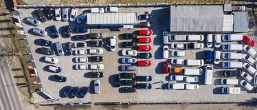 Aerial view cars for sale stock lot row, Car Dealer Inventory, parking lot. Drone stock photo