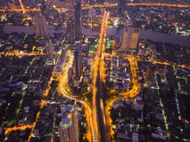 Aerial view of cars on Taksin Bridge in financial district and s. Kyscraper buildings in transportation concept. Top view of urban city at night, Sathorn road stock image