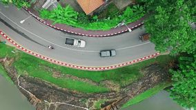 Aerial view of cars, traffic, houses and lake in Chiang Mai City, Thailand