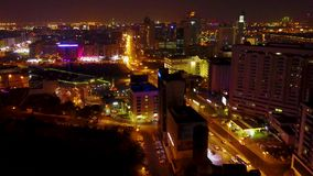 Aerial view on cars and traffic lights at night. Intersection at night. Modern architecture office building. Transportation, rush hour traffic, cars on highway stock video