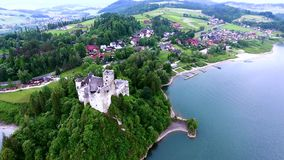 Aerial view of castle on lake bank stock video