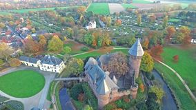 Aerial view of Castle Linn in autumn - Krefeld - Germany stock video footage