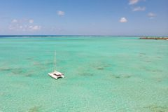 Aerial view of Catamaran boat sailing in turquoise lagoon of Ile aux Cerfs Island lagoon in Mauritius. royalty free stock images