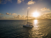 Aerial view of catamaran sailling in coastline stock photos