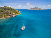 Aerial view of catamaran sailling in coastline. Tropical Seychelles island on background Royalty Free Stock Photography