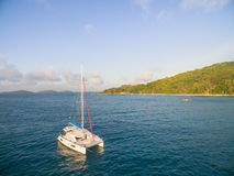 Aerial view of catamaran sailling in coastline. Tropical Seychelles island on background Stock Image