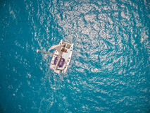 Aerial view of catamaran sailling in ocean. Open water Royalty Free Stock Photography