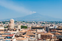 Aerial view of Catania as seen from the dome of a church. In the background volcano Etna with plume Royalty Free Stock Photography