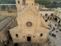 Aerial  View of the Cathedral of St. Maria La Bruna on Cloudy Sky at Sunset. Matera, Italy royalty free stock images