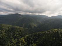 Aerial view. Caucasus Mountains under gloomy cloudy sky. Aerial view. Panorama Caucasus Mountains under gloomy cloudy sky Stock Image