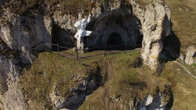 Aerial view cave in rock of sunny day stock footage