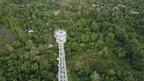 Aerial view of cell phone communication tower in green nature stock footage
