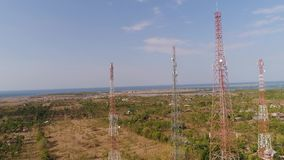 Cell phone towers. Aerial view cell phone towers line in bali, indonesia. Telecommunication tower, communication antenna on coast sea stock video