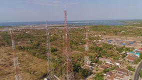Cell phone towers. Aerial view cell phone towers line in bali, indonesia. Telecommunication tower, communication antenna on coast sea stock video footage