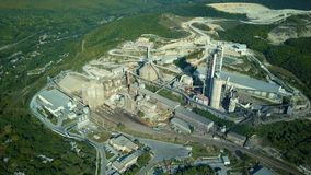 Aerial view of cement factory, large industrial building in the mountains. Concept of cisterns, pipes, metal structures. Concrete production. Top view stock video