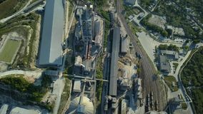 Aerial view of cement factory, large industrial building in the mountains. Concept of cisterns, pipes, metal structures. Concrete production. Top view stock video footage