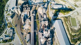Aerial view of cement manufacturing plant. Concept of buildings at the factory, steel pipes, giants. Aerial view of cement manufacturing plant. Concept of royalty free stock photo