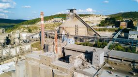 Aerial view of cement manufacturing plant. Concept of buildings at the factory, steel pipes, giants. Aerial view of cement manufacturing plant. Concept of royalty free stock photography