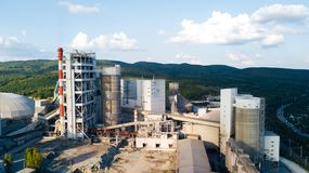 Aerial view of cement manufacturing plant. Concept of buildings at the factory, steel pipes, giants. Aerial view of cement manufacturing plant. Concept of stock photo