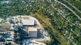 Aerial view of cement manufacturing plant. Concept of buildings at the factory, steel pipes, giants. Aerial view of cement manufacturing plant. Concept of royalty free stock image