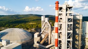 Aerial view of cement manufacturing plant. Concept of buildings at the factory, steel pipes, giants. Aerial view of cement manufacturing plant. Concept of Royalty Free Stock Photos