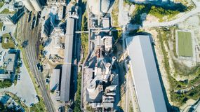 Aerial view of cement manufacturing plant. Concept of buildings at the factory, steel pipes, giants. Aerial view of cement manufacturing plant. Concept of stock image