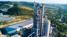 Aerial view of cement manufacturing plant. Concept of buildings at the factory, steel pipes, giants. Aerial view of cement manufacturing plant. Concept of stock photos