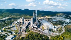 Aerial view of cement manufacturing plant. Concept of buildings at the factory, steel pipes, giants. Aerial view of cement manufacturing plant. Concept of stock photography