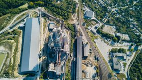 Aerial view of cement manufacturing plant. Concept of buildings at the factory, steel pipes, giants. Aerial view of cement manufacturing plant. Concept of royalty free stock images