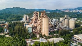 Aerial view cement plant factory manufacturing, Cement factory m. Achinery on a blue sky background stock images