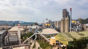 Aerial view cement plant factory manufacturing, Cement factory m. Achinery on a blue sky background stock photography