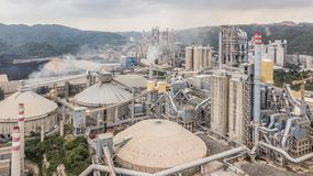 Aerial view cement plant factory manufacturing, Cement factory m. Achinery on a blue sky background royalty free stock image