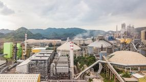Aerial view cement plant factory manufacturing, Cement factory m. Achinery on a blue sky background royalty free stock photo