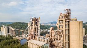 Aerial view cement plant factory manufacturing, Cement factory m. Achinery on a blue sky background stock photo