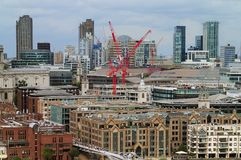 Aerial view on cental London buildings. Aerial view on central London buildings, offices and apartments close to Millennium bridge on a gloomy day with gray sky royalty free stock photography