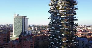 Aerial view of the center of Milan, panoramic view of the Vertical Forest, Milan, Porta Nuova residences and skyscrapers, Italy, stock video