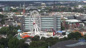 Hamburg aerial, Dom. Aerial view of central Hamburg, focusing on the Hamburger Dom, an funfair area dedicated to entertainment like ferris wheel and carousels stock video