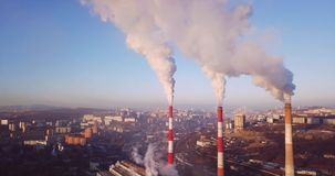 Aerial view of Central Heating and Power Plant chimneys with steam. Sunrise stock footage