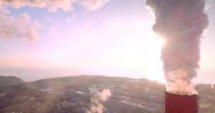 Aerial view of Central Heating and Power Plant chimneys with steam. Sunrise stock video footage
