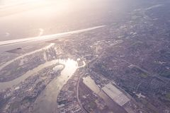 Aerial view of Central London through airplane window vintage c. Olour Royalty Free Stock Image