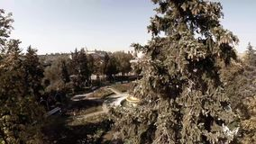 Aerial view of Central Moscow Gorky park. Crowds of people walking over central park in Moscow, Russia. Moscow river bank, park full of green trees on a sunny stock video footage