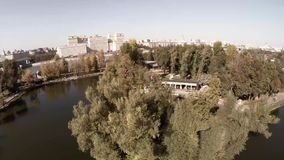 Aerial view of Central Moscow Gorky park and lake, fontain, main entrance. Aerial view of Central Moscow Gorky park. Crowds of people walking over central park stock video