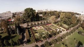 Aerial view of Central Moscow Gorky park and lake, fontain, main entrance. stock footage