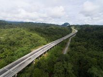 Aerial view of Central Spine Road CSR highway located in kuala lipis, pahang, malaysia stock images