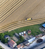 Aerial View : Cereal harvest close by a farm. With nice cultivation lines Royalty Free Stock Photos