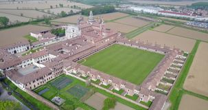Aerial view of the Certosa di Pavia,  the monastery and shrine in the province of Pavia, Lombardia, Italy stock footage